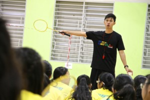 Teacher giving instructions during badminton lesson